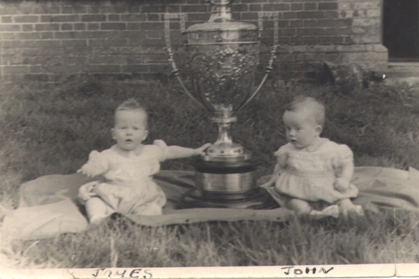 Jimmy Clabburn won the Gold Cup in 1946 sailing 3 Purple Emperor. The Clabburn twins were photographed beside the trophy. James (left) was commodore of the Norfolk Broads Yacht Club last year.